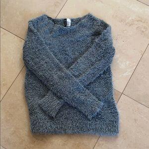 grey fuzzy sweater
